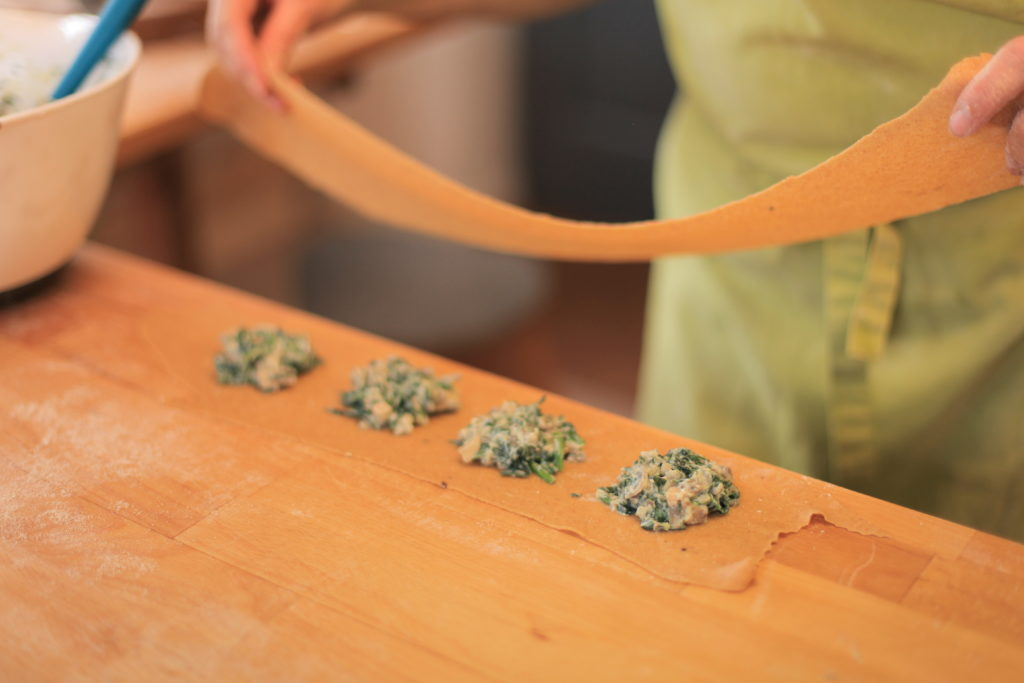 Filling our ravioli with spinach, ricotta and wild garlic!